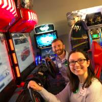 Two people playing arcade games